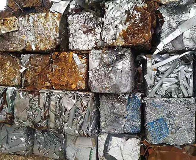 waste metal scraps are baled for recycling